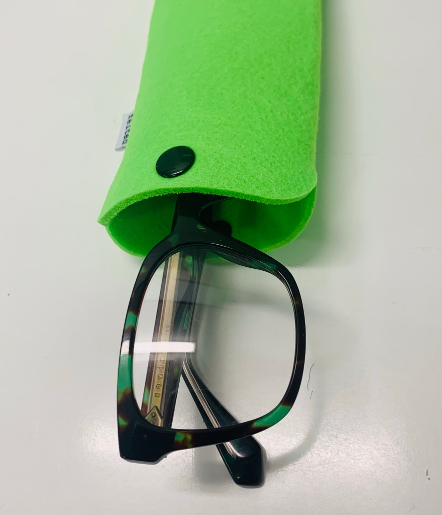 A green case with small glasses